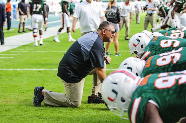 Coach Kuligowski running the defensive line through drills