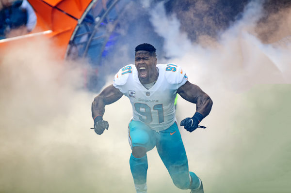 Cameron Wake screams as he comes out through the tunnel