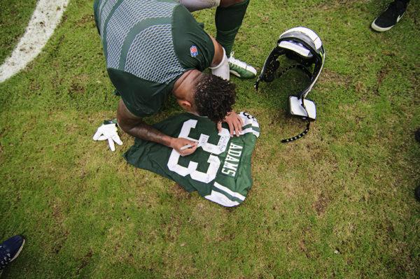Jamal Adams signs his jersey