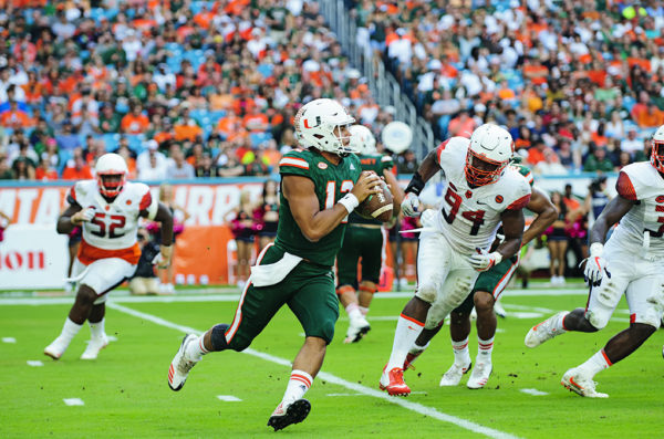 Malik Rosier looks to throw on the run