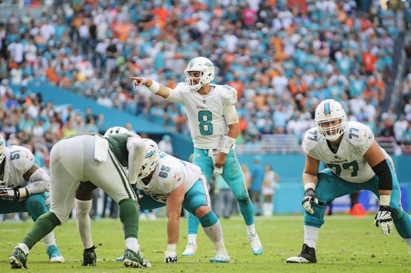 Matt Moore (8) calls out the defense assignments