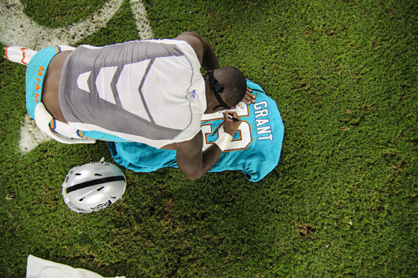 Jakeem Grant (19) writes a message on his jersey