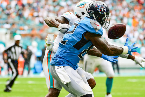 Miami Dolphins cornerback Bobby McCain (28) breaks up the pass to Tennessee Titans tight end Delanie Walker (82)