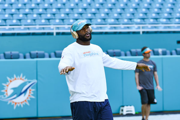 Miami Dolphins defensive end Andre Branch (50) enjoys his music during stretching