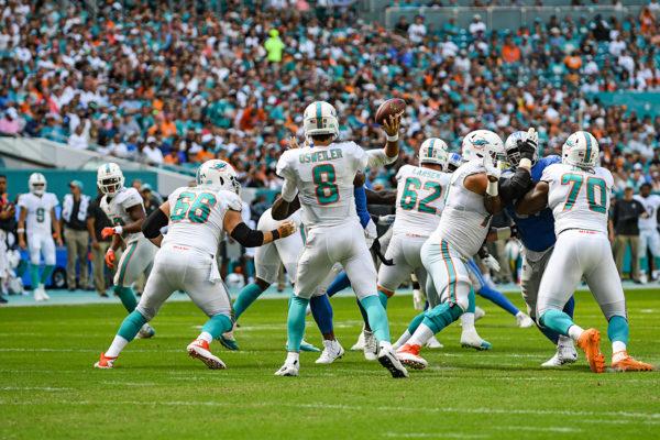 Miami Dolphins quarterback Brock Osweiler (8) looks to throw