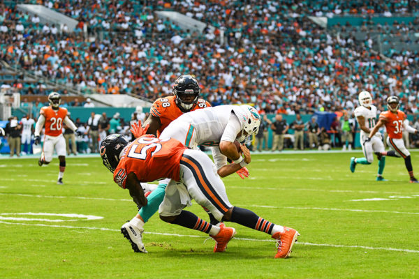 Chicago Bears inside linebacker Danny Trevathan (59) hits Miami Dolphins quarterback Brock Osweiler (8) as he tries for a first down
