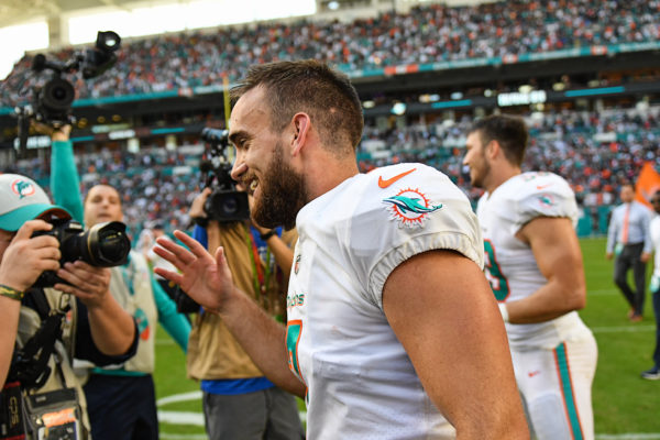Miami Dolphins kicker Jason Sanders (7) is all smiles after kicking the winning field goal in overtime