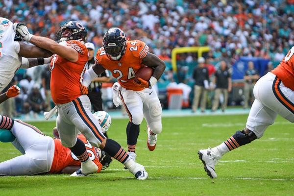 Chicago Bears running back Jordan Howard (24) uses his linemen to open holes for him to run through