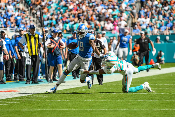 Detroit Lions wide receiver Kenny Golladay (19) with a stiff arm to Miami Dolphins strong safety T.J. McDonald (22)