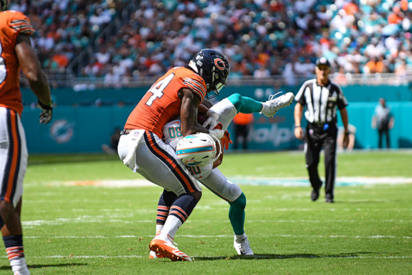 Chicago Bears outside linebacker Leonard Floyd (94) picks up Miami Dolphins wide receiver Danny Amendola (80) prior to slamming him down WWE style