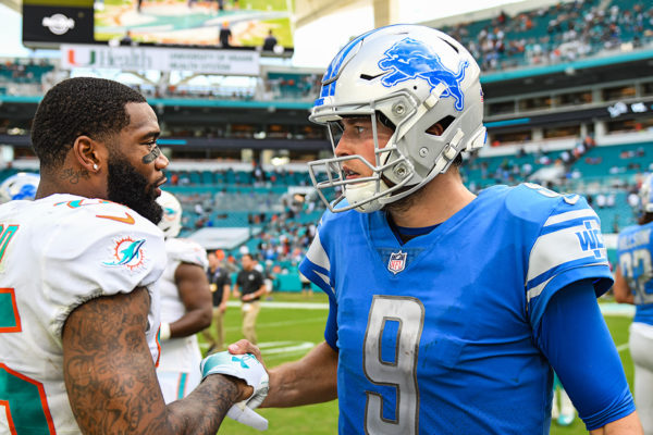 Detroit Lions quarterback Matthew Stafford (9) and Miami Dolphins cornerback Xavien Howard (25) after the game