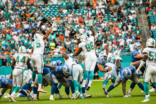 The Miami Dolphins special teams tries to block the kick
