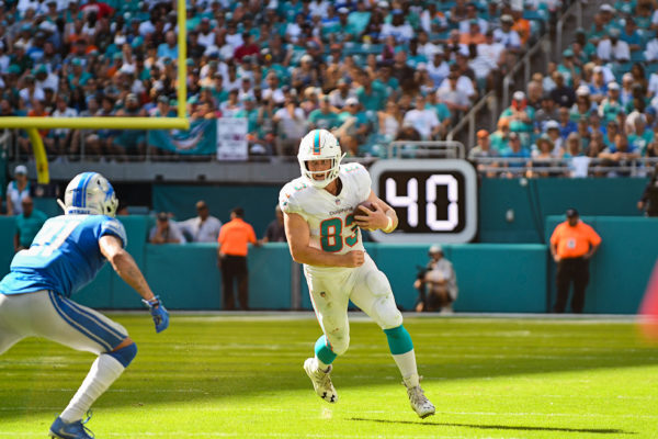 Miami Dolphins tight end Nick O'Leary (83) runs after a catch