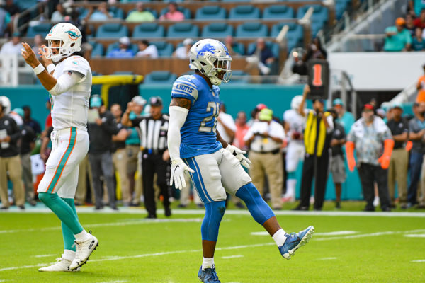 Detroit Lions strong safety Quandre Diggs (28) celebrates stopping the run