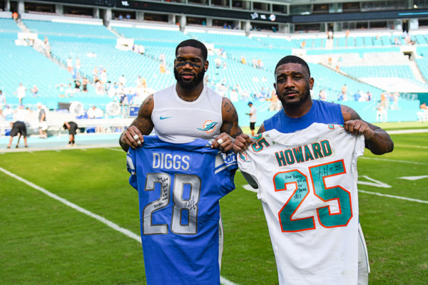 Miami Dolphins cornerback Xavien Howard (25) and Detroit Lions strong safety Quandre Diggs (28) exchange jerseys