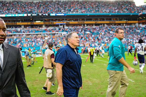 New England Patriots head coach Bill Belichick watches the Dolphins winning play on the jumbotron