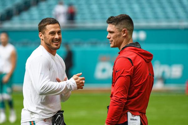 Miami Dolphins wide receiver Danny Amendola (80) and New England Patriots wide receiver Chris Hogan (15) catch up