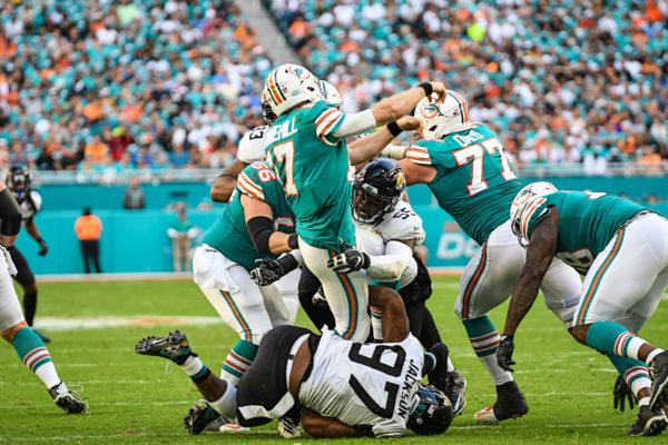 Miami Dolphins quarterback Ryan Tannehill (17) gets hit as he throws