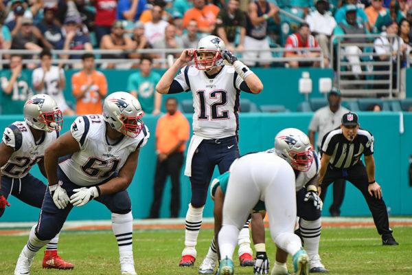 New England Patriots quarterback Tom Brady (12) calls an audible
