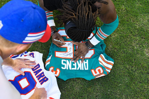 Miami Dolphins defensive back Walt Aikens (35) signs his jersey