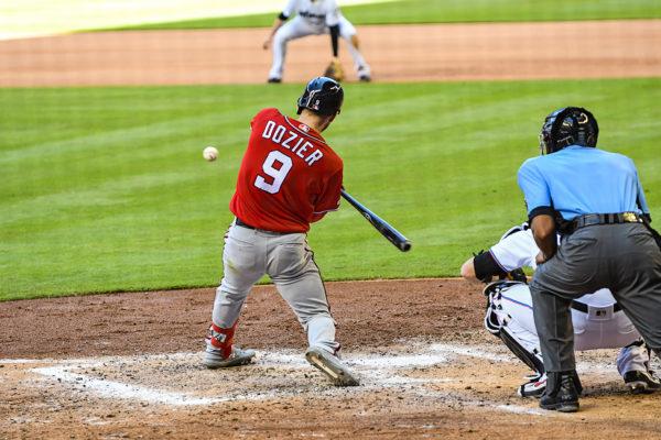 Washington Nationals second baseman Brian Dozier #9 hits a homerun