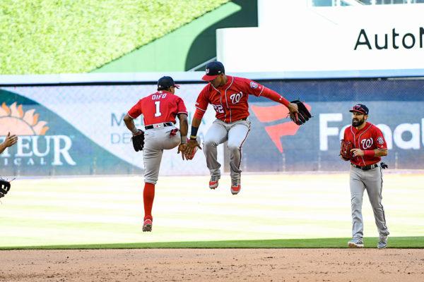 Washington Nationals left fielder Juan Soto #22 and Washington Nationals shortstop Wilmer Difo #1