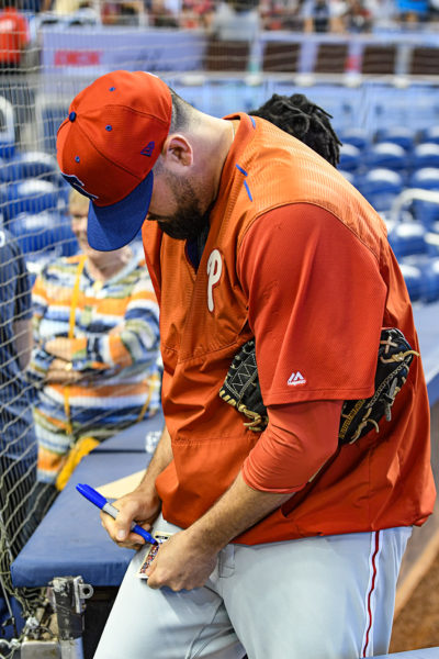 Philadelphia Phillies relief pitcher Pat Neshek (93) signs an autograph