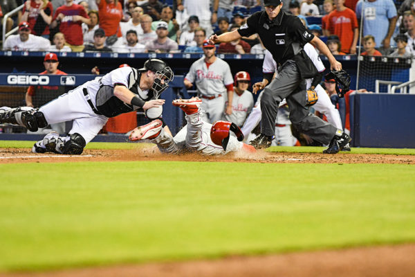 Philadelphia Phillies right fielder Bryce Harper (3) is tagged out at home by Miami Marlins catcher Chad Wallach (17)