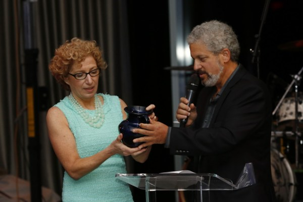 Cookie Till accepting an award by Katz JCC Board President Eric Goldstein