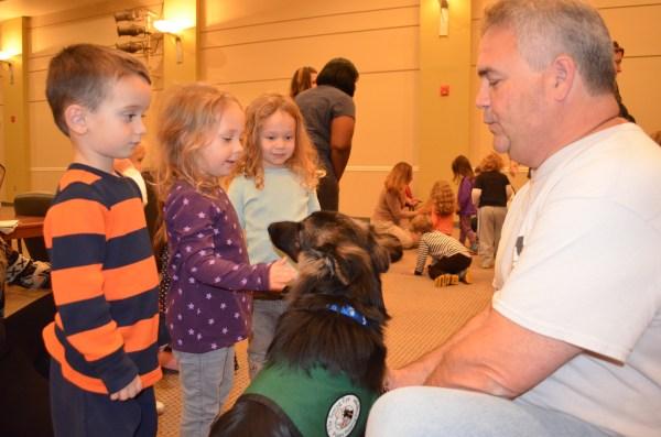 Julia Koch of Margate pets the dog