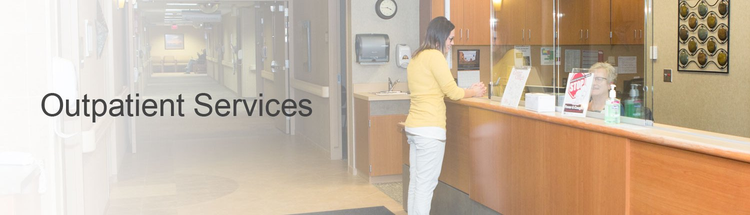 Woman standing at Health Center main desk in lobby