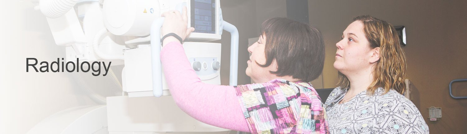Radiologists examining x-ray results to diagnose patient