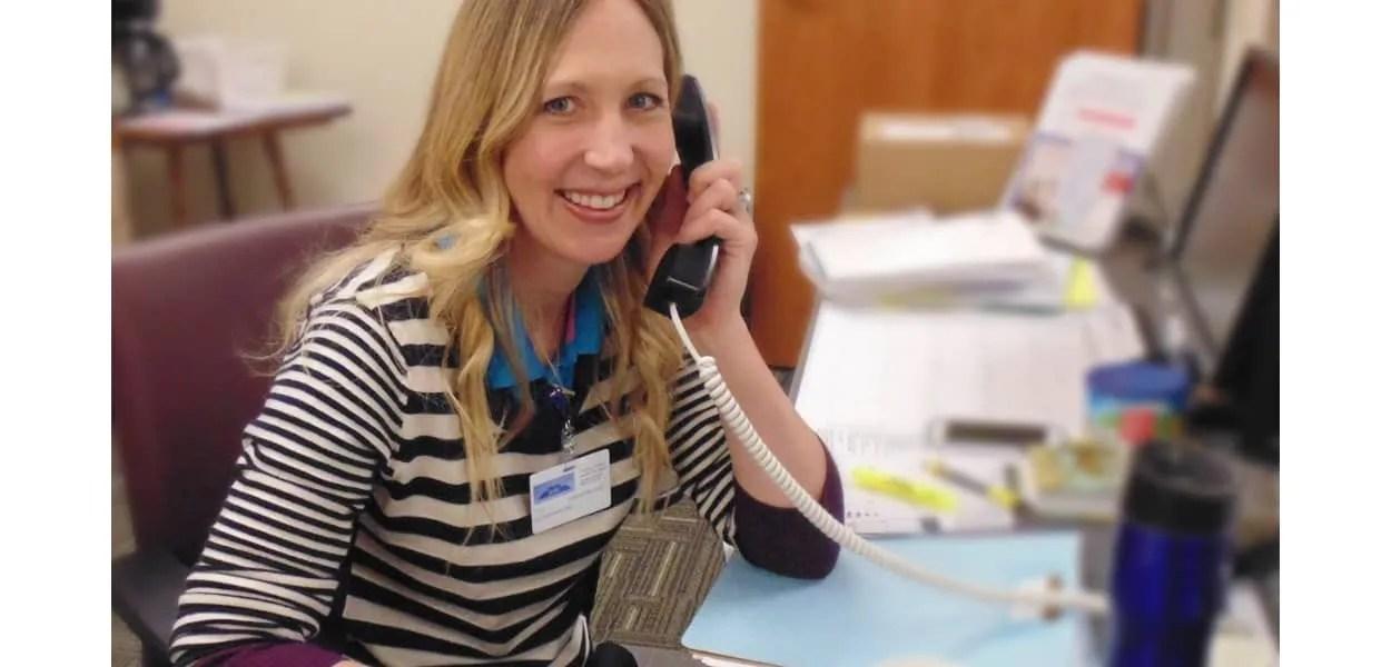 Julia on the phone in Wellness & Cardiac Rehabilitation