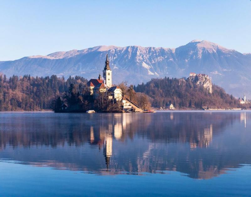 Throwback to Lake Bled in Slovenia  Morning ShotOniPhone Churchhellip