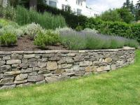 Building a Stone Retaining Wall - JCs Landscaping