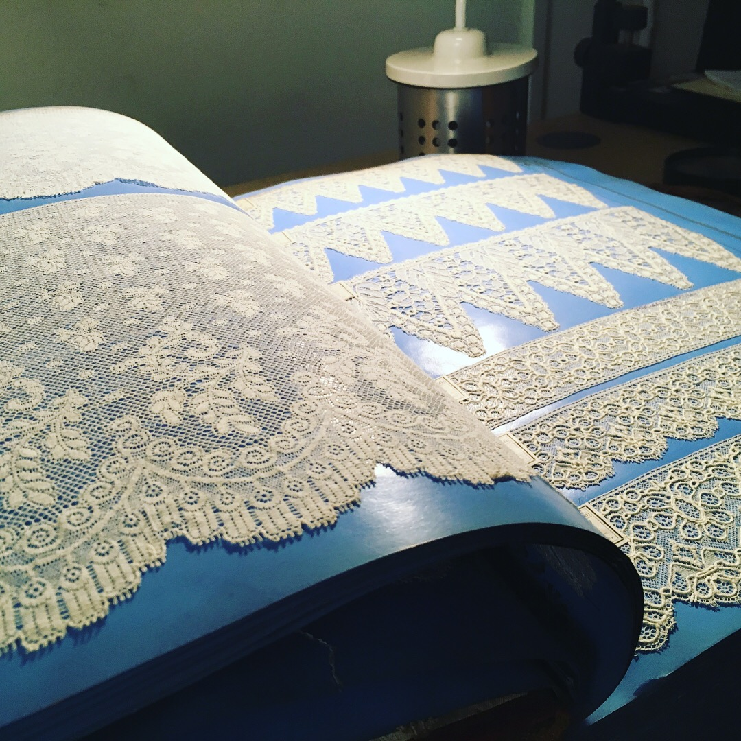 picture of a lace lace sample book from Nottingham Trent University Lace Archive
