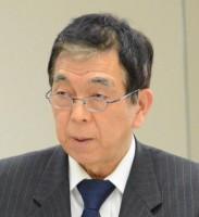 委員会で質問する吉田信夫都議=4日、東京都議会(「しんぶん赤旗」提供)