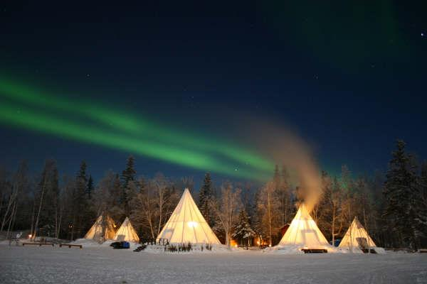 Northern Lights Over Tipi and Frozen Antarctic Waves