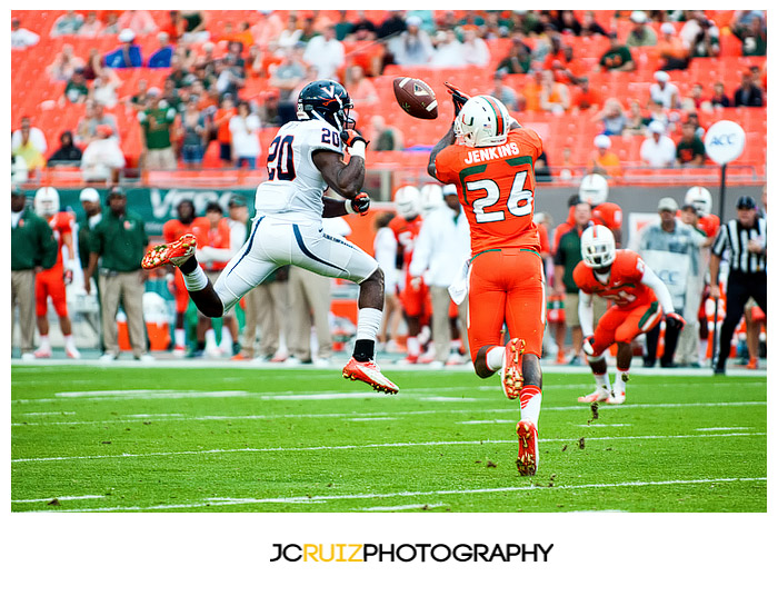 Hurricanes DB #26, Rayshawn Jenkins, tries to haul in a tipped pass intended for #20, Tim Smith, of the Cavaliers