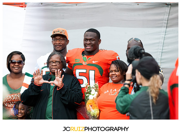 #51, Shayon Green, poses with family prior to the game for Senior Day