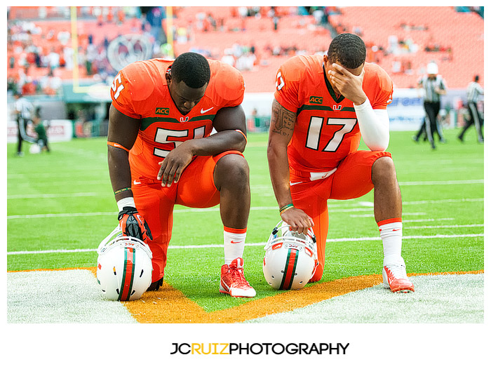 Seniors #51, Shayon Green, and #17 Stephen Morris, have a moment of silence together prior to the kickoff