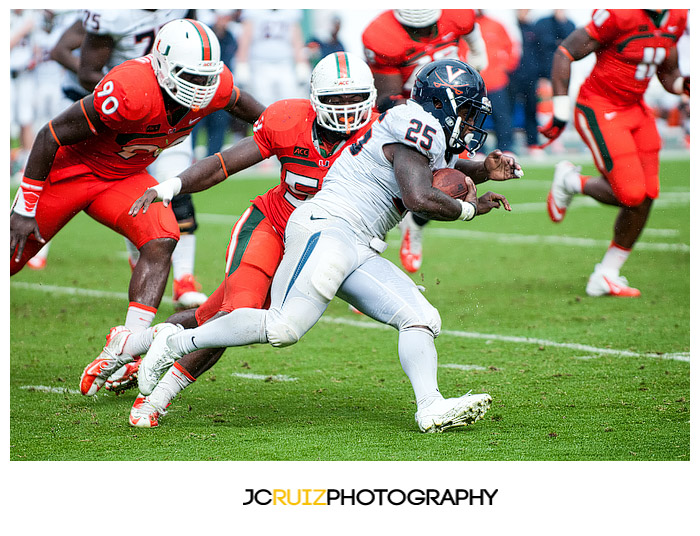 Virginia RB #25, Kevin Parks, runs past Miami LB #59, Jimmy Gaines