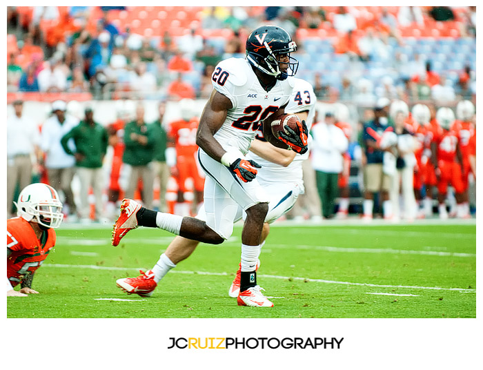 #20, Tim Smith, of the Virginia Cavaliers returns a punt against the Miami Hurricanes