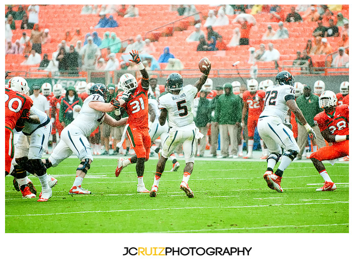 Virginia QB, #5 David Watford, attempts a pass against Miami in a South Florida downpour