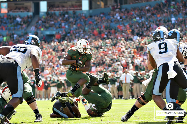 Duke Johnson leaps over players on his way to a touchdown