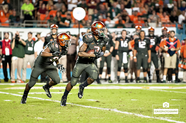 Miami Hurricanes WR #3, Stacy Coley, takes the handoff from Miami Hurricanes RB #8, Duke Johnson