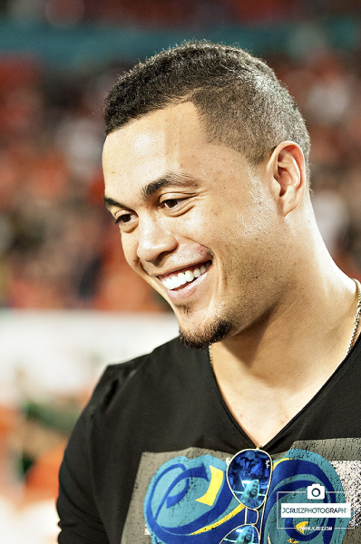 Miami Marlins outfielder, Giancarlo Stanton, answers media questions on the sideline prior to the Miami Hurricanes vs. FSU game