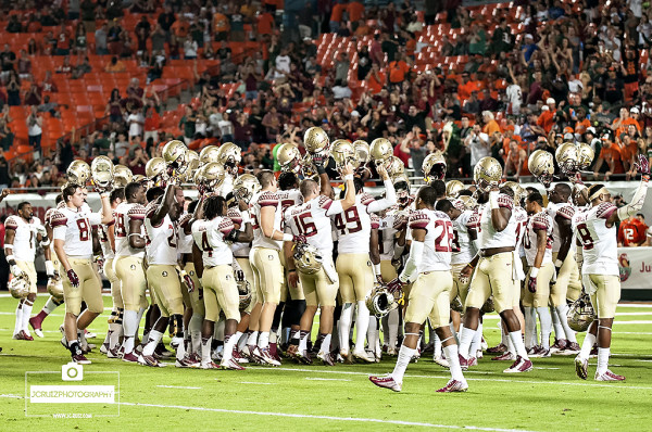 Florida State Seminoles get together after stretching drills