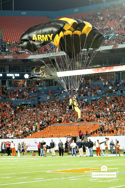 United States Army Golden Knights parachute team touchdown in Sun Life Stadium prior to kick off