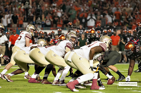 Florida State QB #5 Jameis Winston calls an audible at the line of scrimmage
